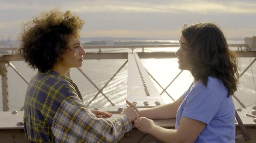 Ilana and Abbi hold hands on Brooklyn Bridge