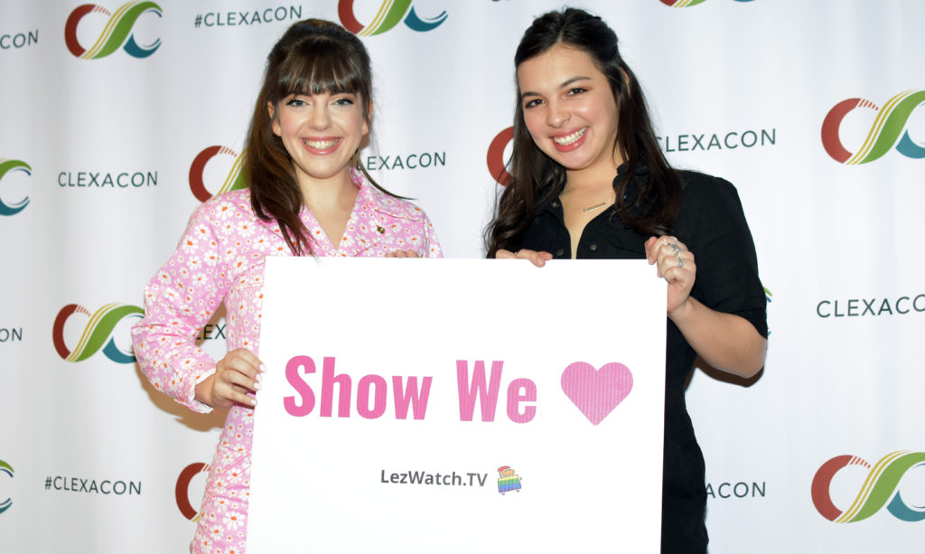 Sheridan Pierce and Isabella Gomez  with the LezWatchTV Show We Love sign